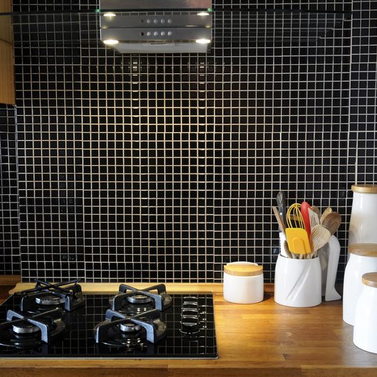 Wooden worktop with small black tiles